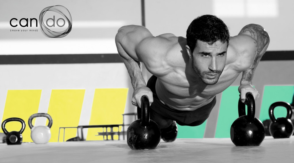Gym man push-up strength pushup exercise with Kettlebell in a wo